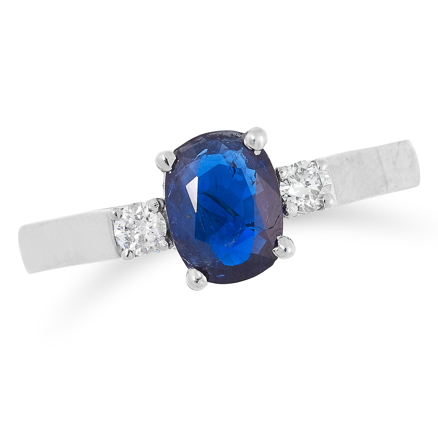SAPPHIRE AND DIAMOND THREE STONE RING set with an oval cut sapphire between two round cut