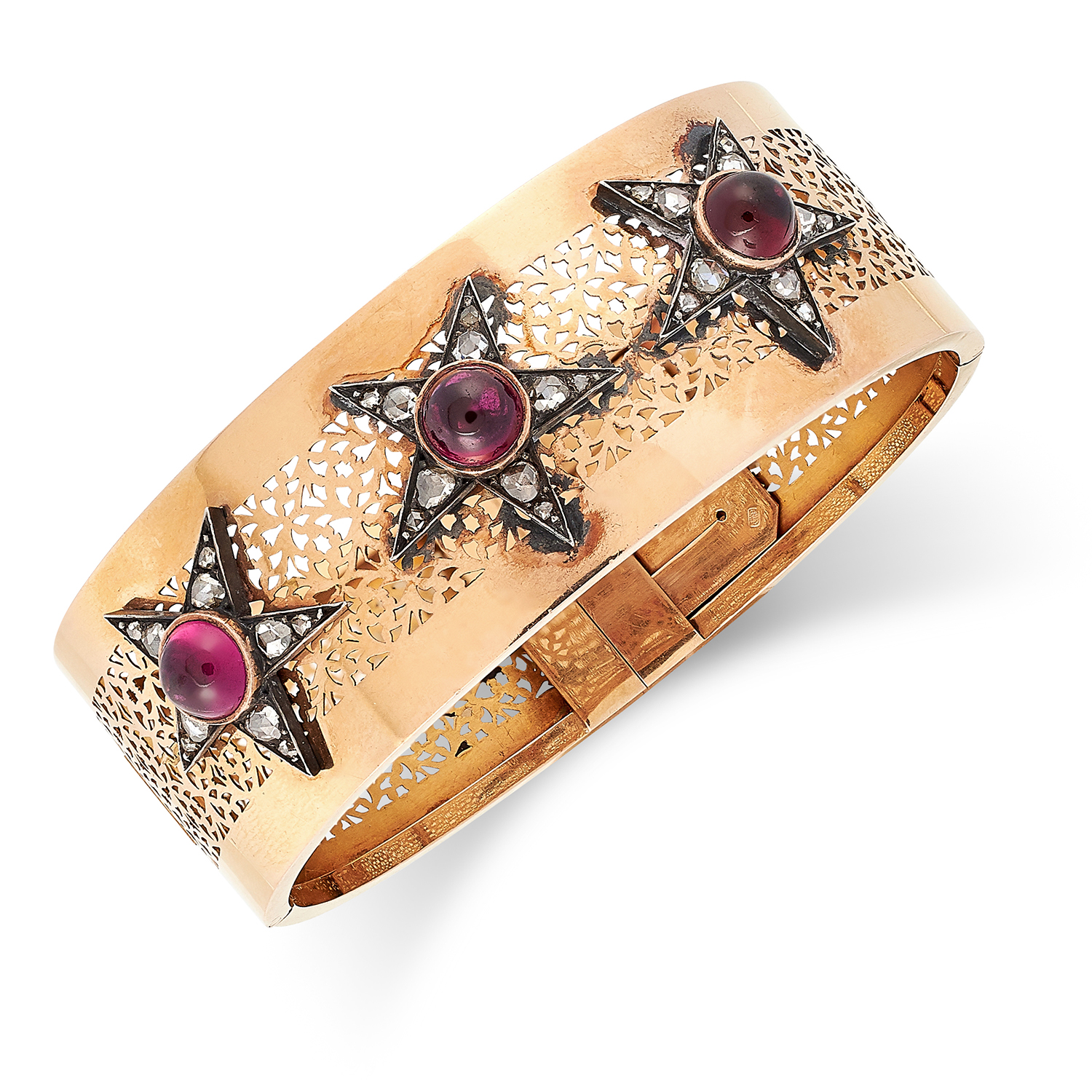 A RUBY AND DIAMOND BANGLE set with cabochon garnets and rose cut diamonds in star motif, 6cm inner