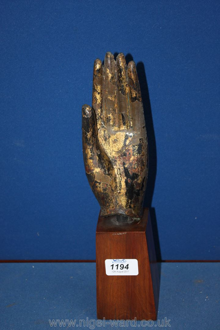 Lot 1194 - An early Thai Ayutthaya bronze Buddha hand 15th -17th century with extensive remains of black