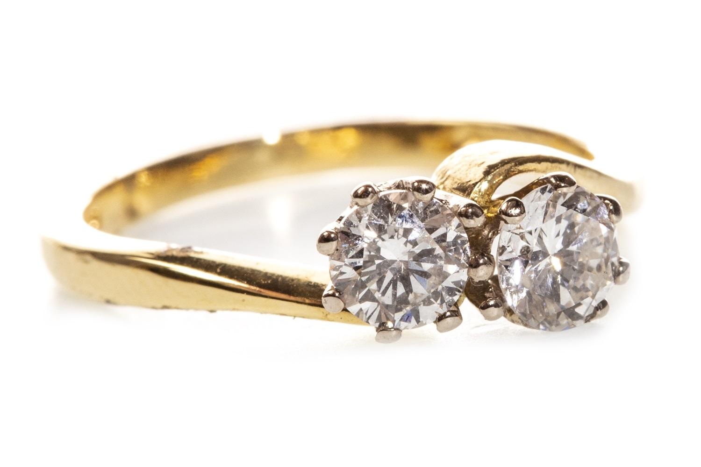 Lot 58 - A DIAMOND TWO STONE RING