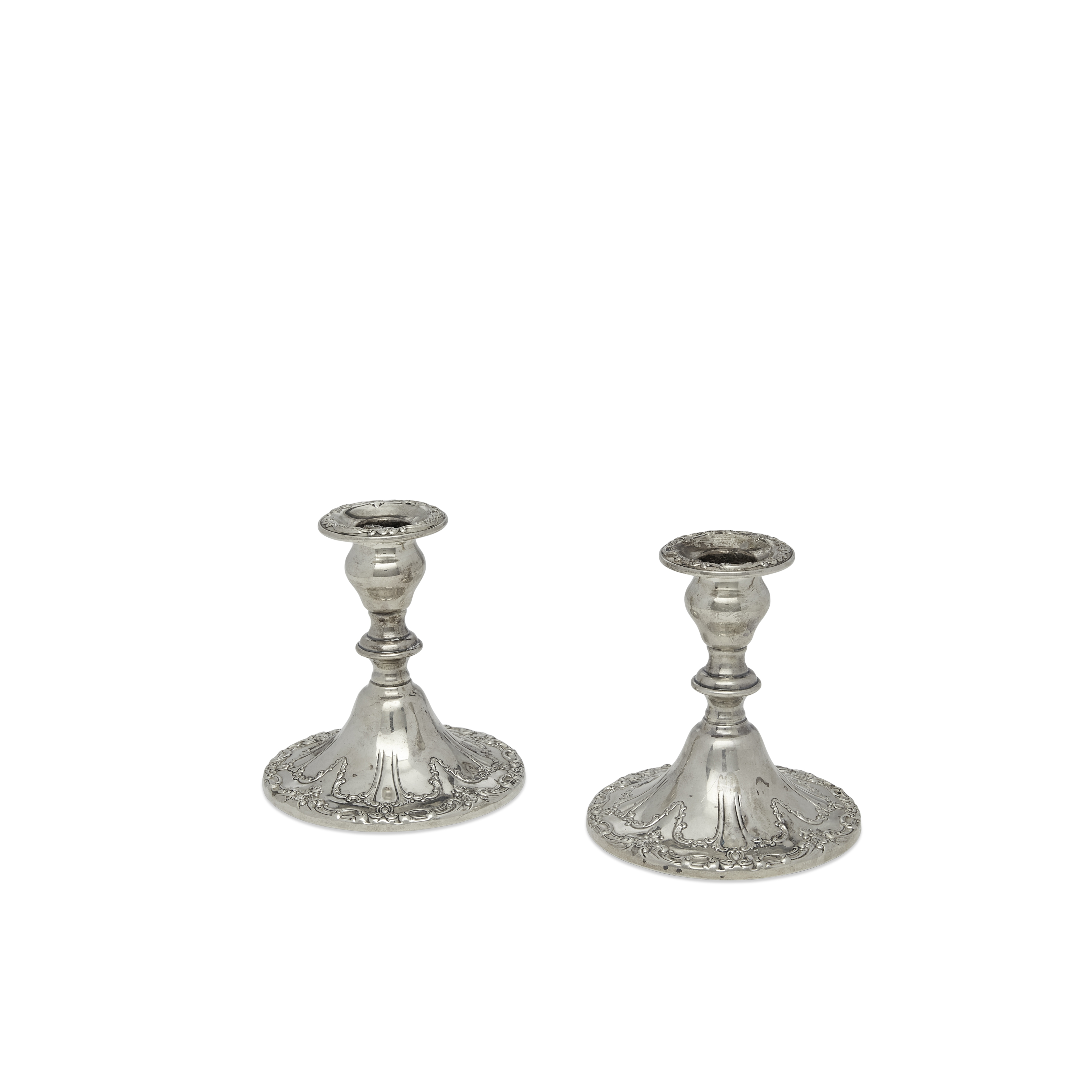An pair of American weighted sterling silver console candleholders by Gorham Mfg. Co., Providence...