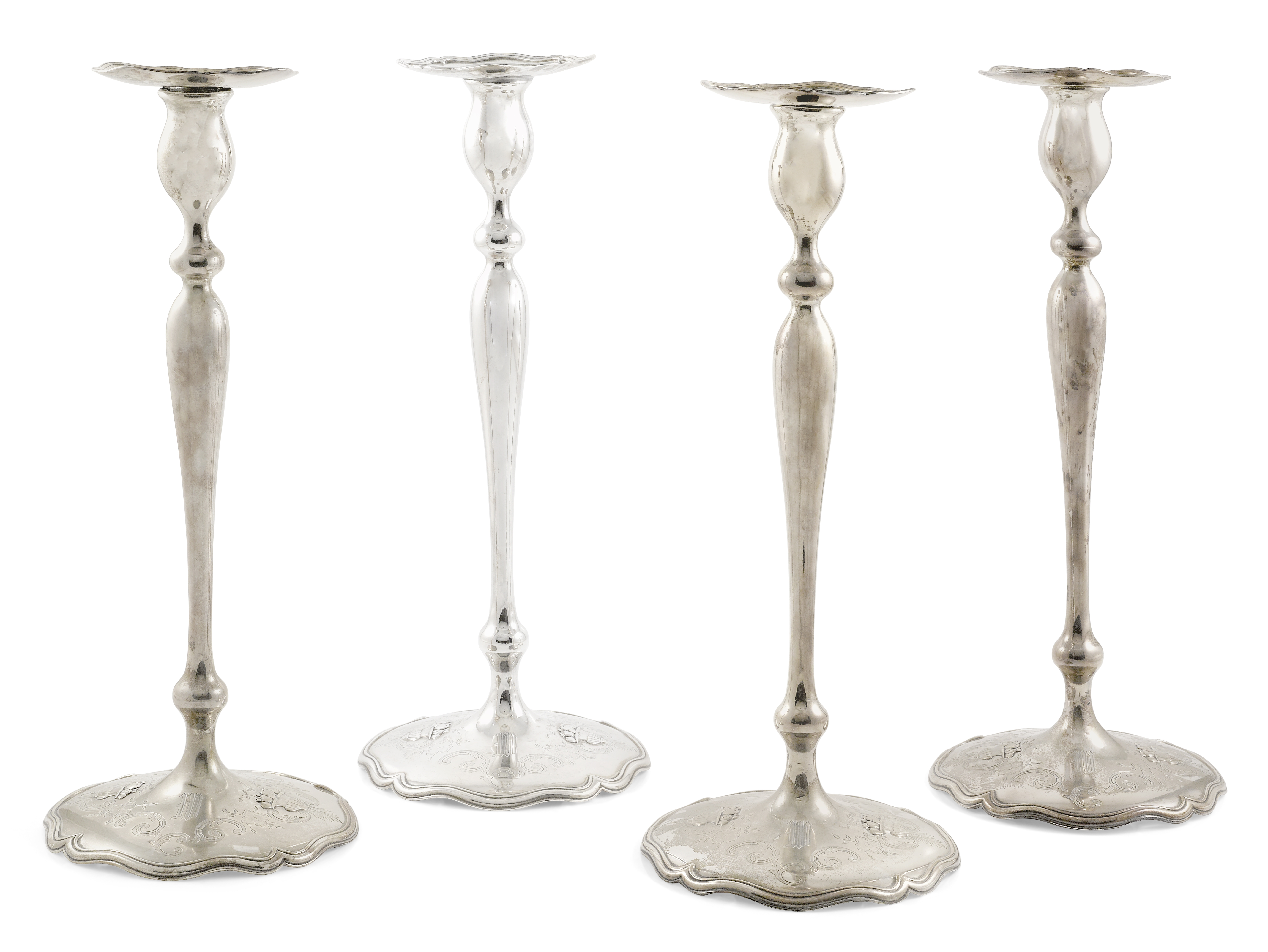 Four American sterling silver base loaded candlesticks by Shreve & Co., San Francisco, CA, 20th c...