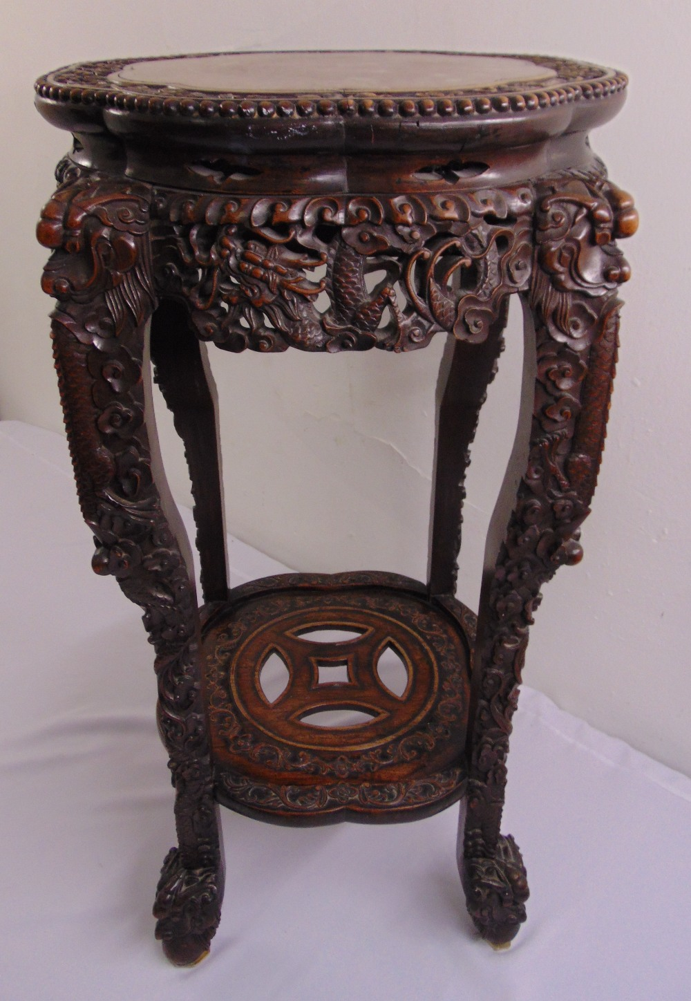 Lot 10 - A Chinese 19th century hardwood shaped circular side table with inset marble top the sides and