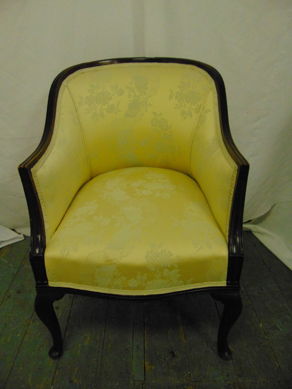 Lot 33 - An early 20th century upholstered tub chair on scroll legs
