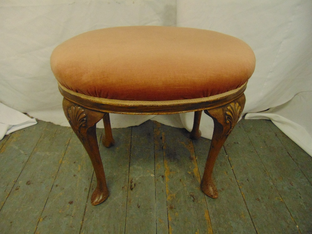 Lot 35 - A mahogany upholstered stool on four cabriole legs