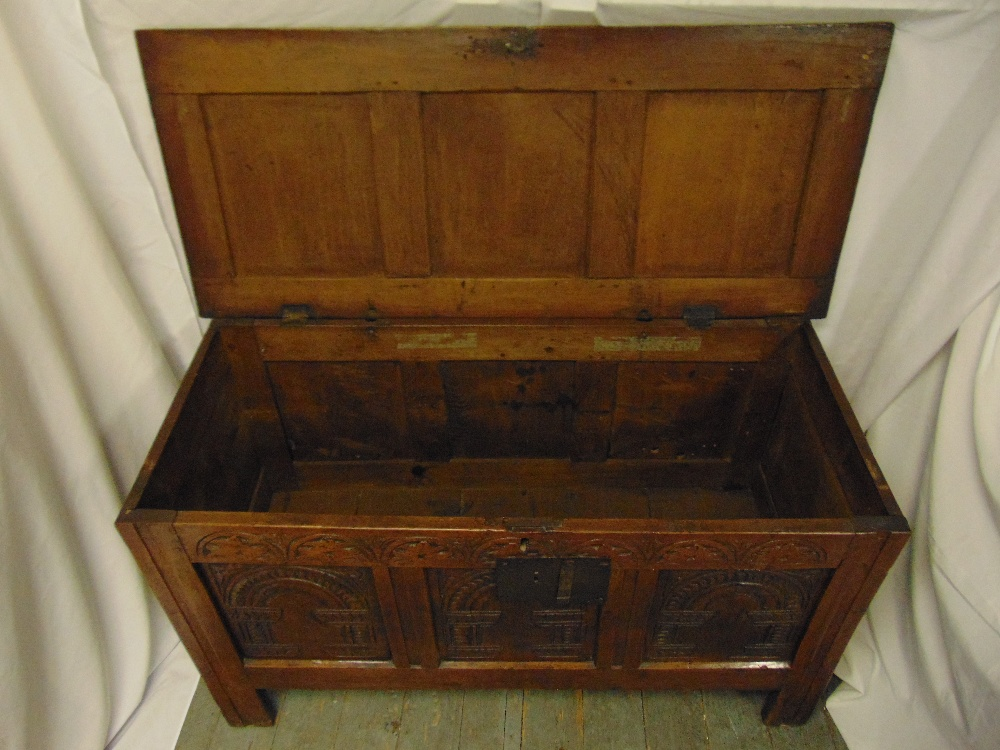 Lot 17 - A rectangular oak chest panelled sides, hinged cover on four bracket feet