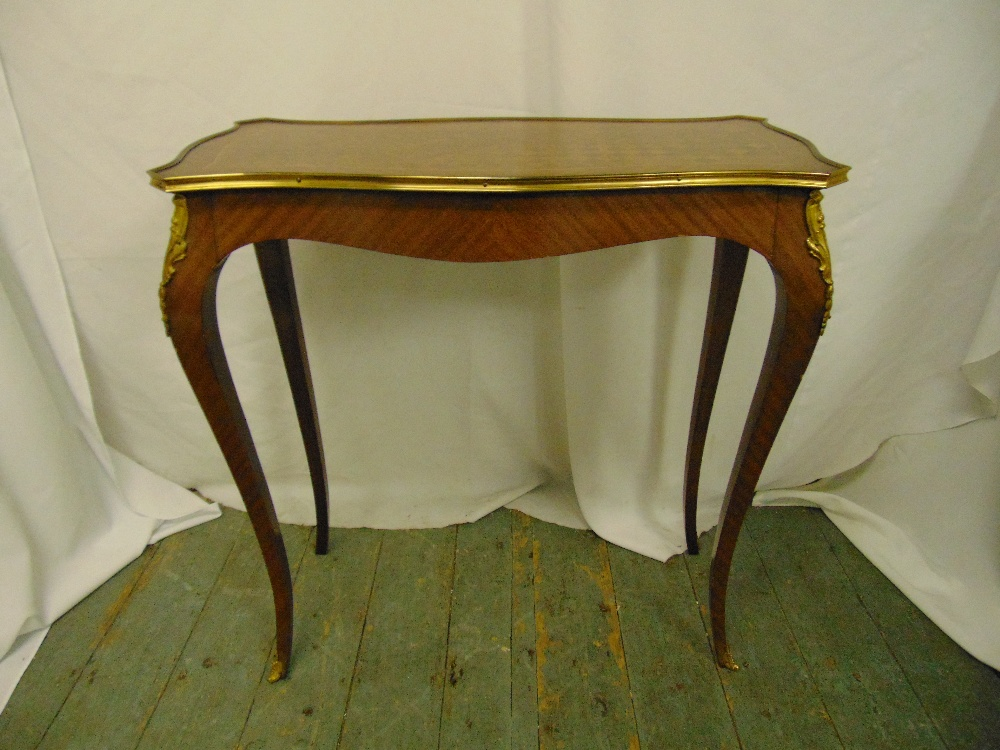 Lot 8 - A rectangular Kingswood hall table with applied brass mounts on four cabriole legs