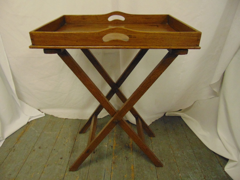 Lot 24 - A rectangular wooden butlers tray on articulated stand