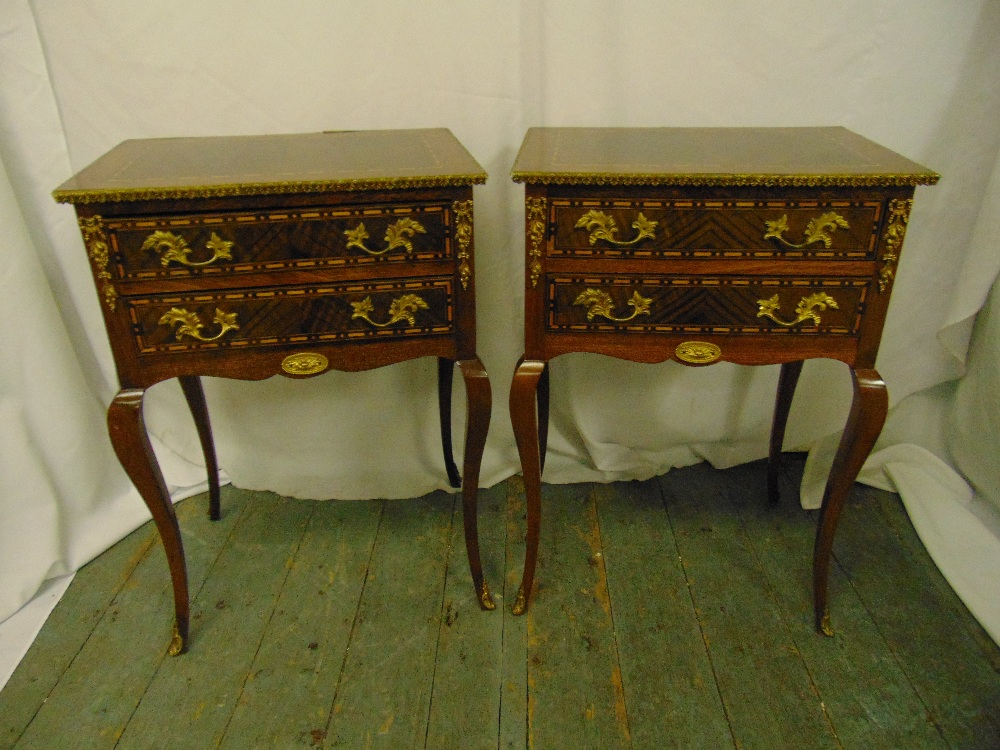 Lot 6 - A pair of inlaid Kingswood rectangular side tables each with two drawers on four cabriole legs