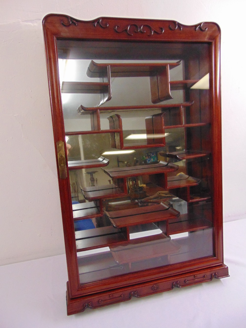 Lot 12 - A wall mounted Oriental style miniatures display cabinet with mirrored back