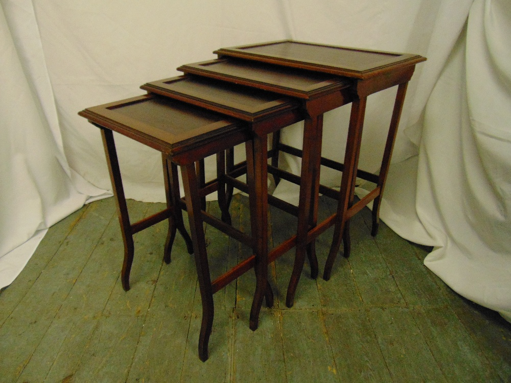 Lot 15 - Carl Hiess a nest of four rectangular mahogany tables