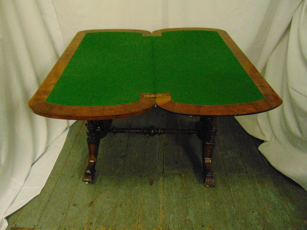 Lot 13 - A Victorian mahogany rectangular games table, hinged top on scrolling supports