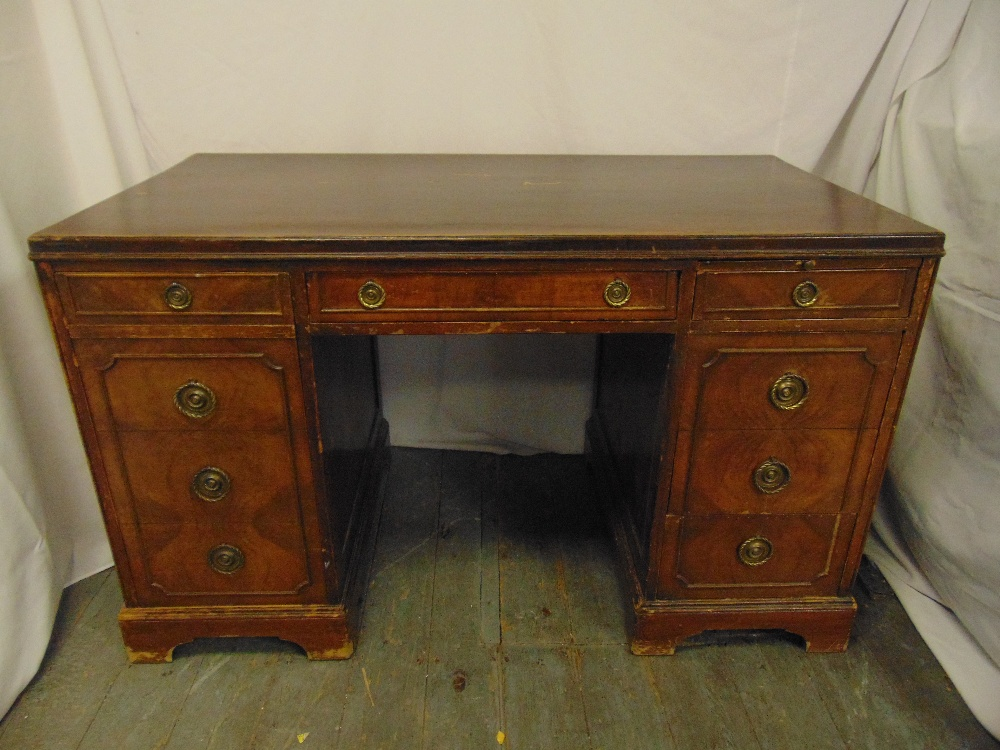 Lot 3 - An early 20th century rectangular mahogany partners desk with brass swing handles on bracket feet,
