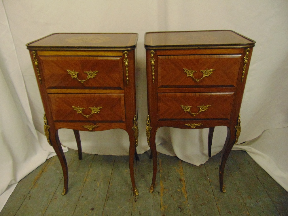 Lot 7 - A pair of rectangular two drawer side tables with applied gilded metal mounts on four cabriole legs