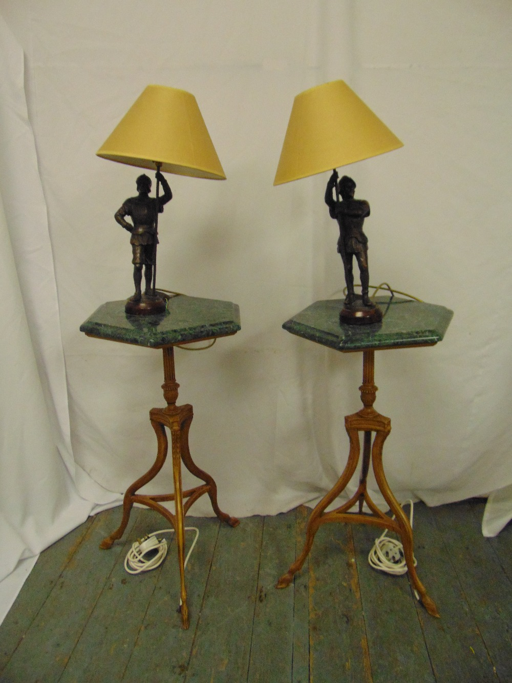 Lot 26 - A pair of hexagonal marble top side tables on triform bases with spelter figural table lamps and