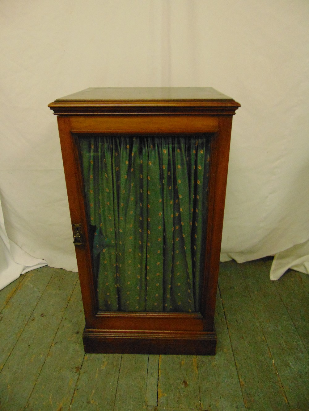 Lot 19 - A Regency rectangular mahogany cabinet with hinged glazed door on rectangular plinth