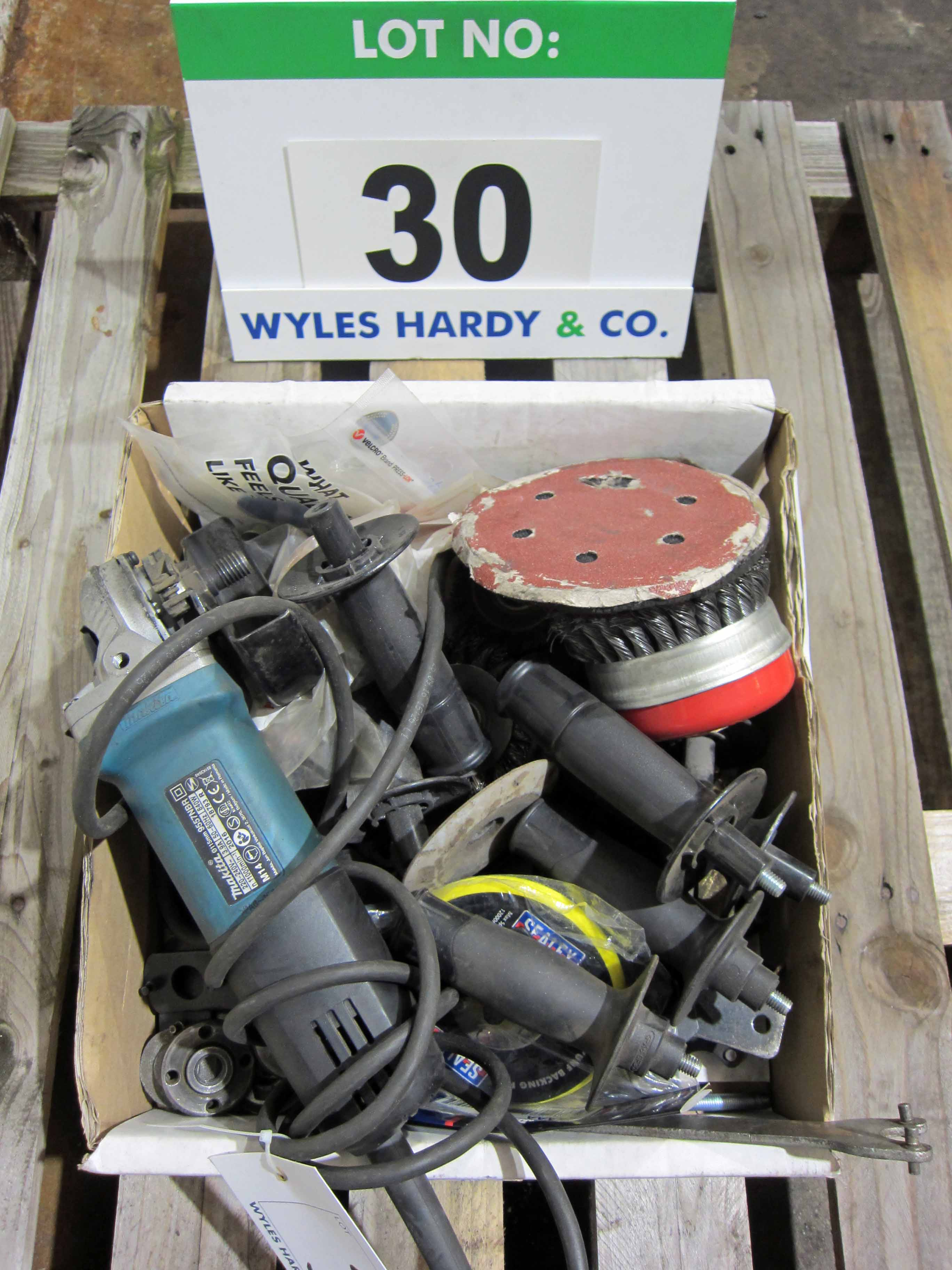 A MAKITA 115mm 240V Angle Grinder (Not Working) and A Quantity of Assorted Angle Grinder Sundries,