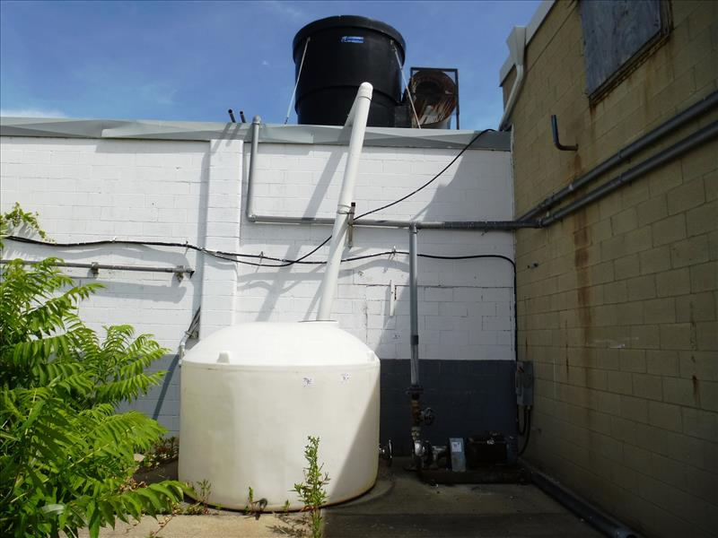 Lot 9E - Delta Pioneer Forced Draft cooling tower (on roof) c/w plastic tank, blower & Tri-Clover s/s pump,