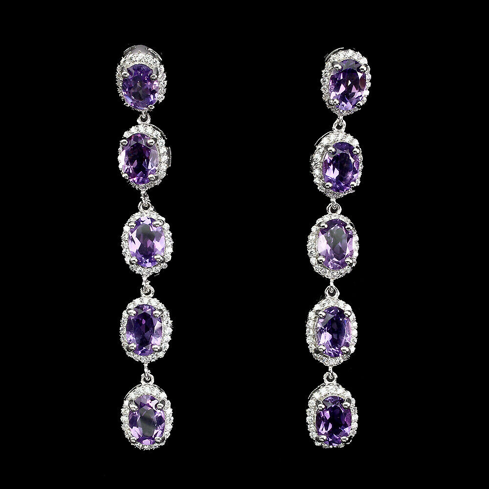 A pair of 925 silver drop earrings set with oval cut amethysts and white stones, L. 5.5cm.