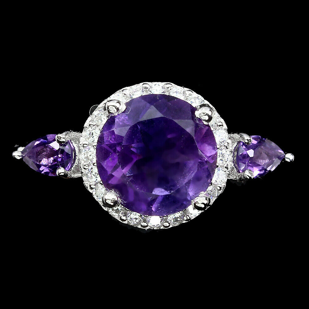 A 925 silver ring set with round and pear cut amethysts, (M).