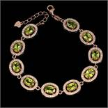 A 925 silver rose gold gilt bracelet set with oval cut peridots and white stones, L. 19cm.
