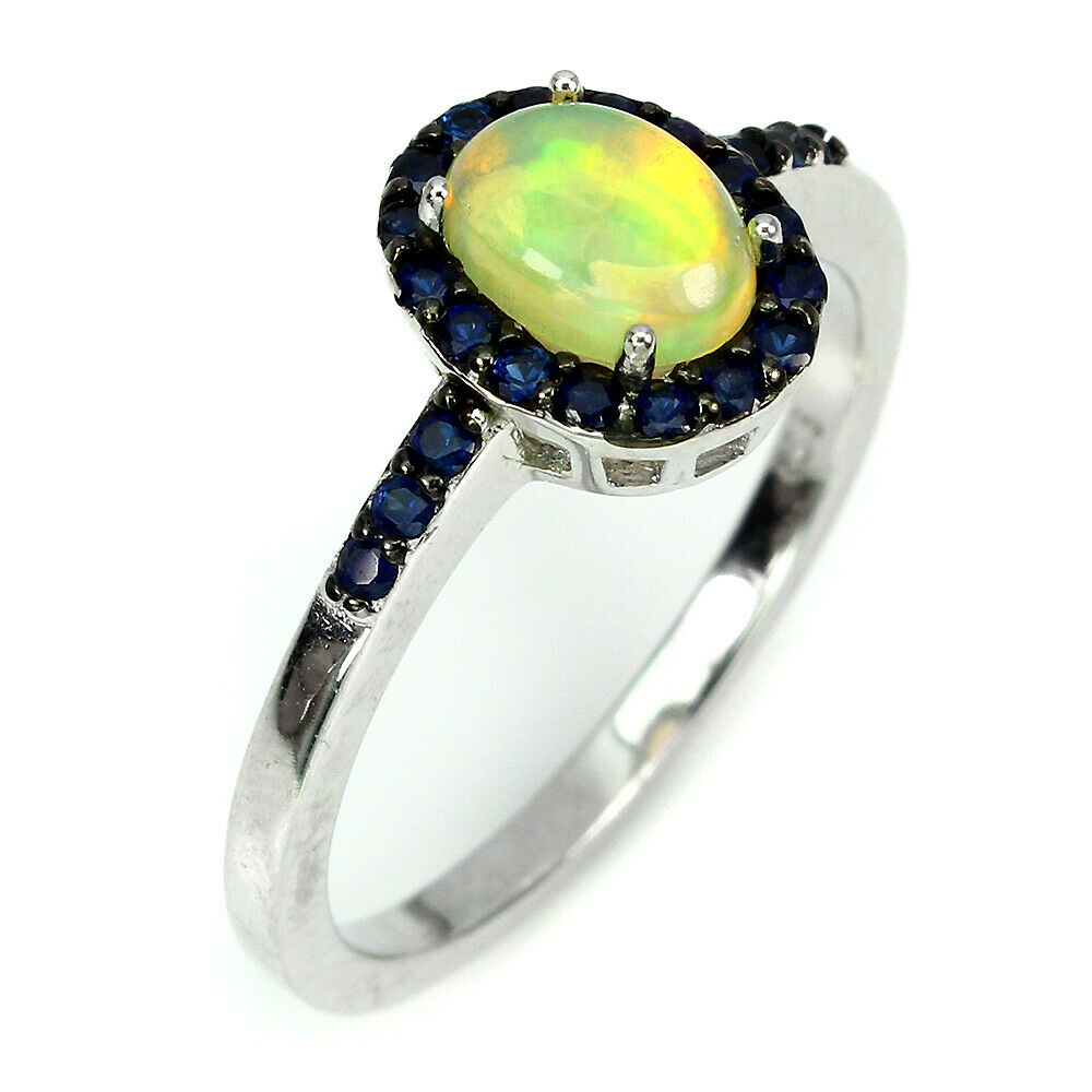 A 925 silver cluster ring set with a cabochon cut opal and sapphires, (P). - Image 2 of 2