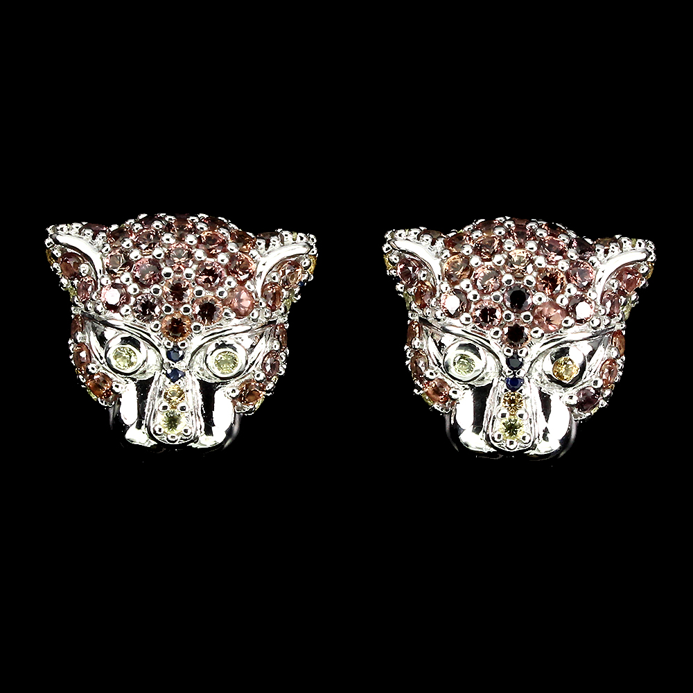 A pair of 925 silver tiger head shaped stud earrings set with fancy yellow and orange sapphires,