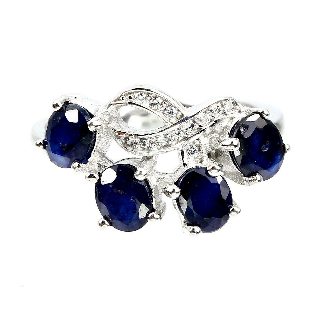 A 925 silver ring set with sapphires and white stones, (M).