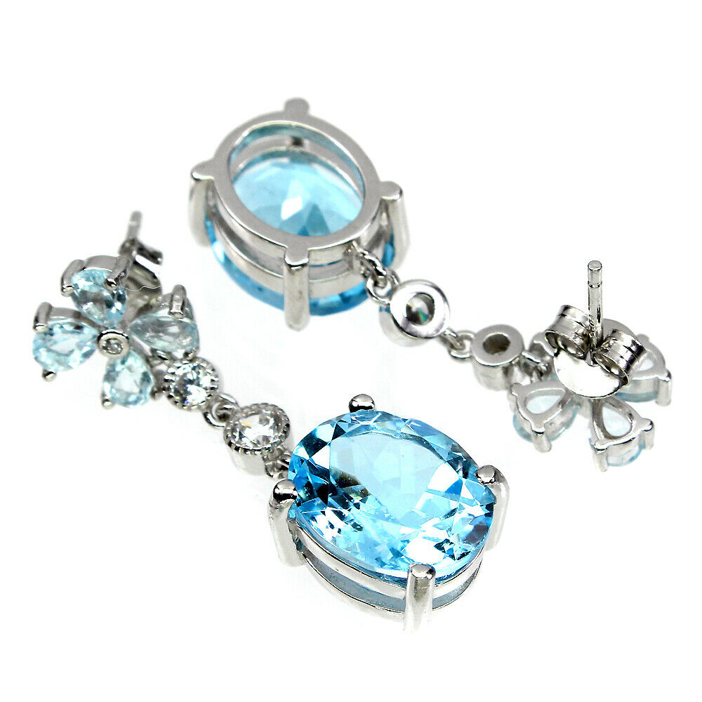 A pair of 925 silver drop earrings set with aquamarines and oval cut Swiss blue topaz, L. 3cm. - Image 2 of 2
