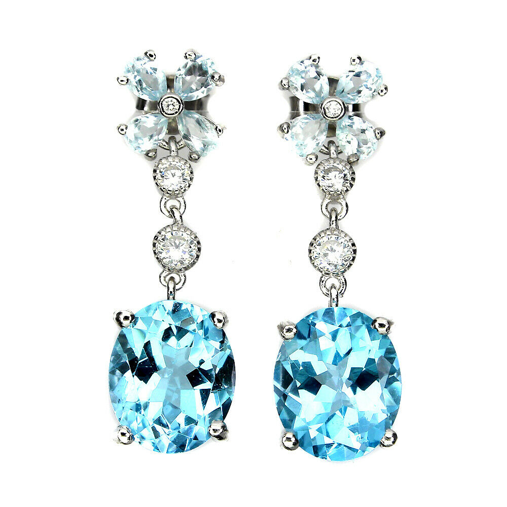 A pair of 925 silver drop earrings set with aquamarines and oval cut Swiss blue topaz, L. 3cm.