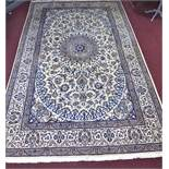 A large part silk Persian Nain Isfahan carpet, central medallion and stylised floral motifs on a