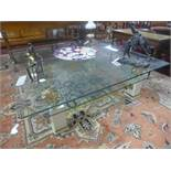 A two tier glass coffee table, with painted wooden supports with gilt brass lion stands, H.40 W.