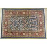 A small pure silk William Morris design Persian rug, signed, with all over stylised floral