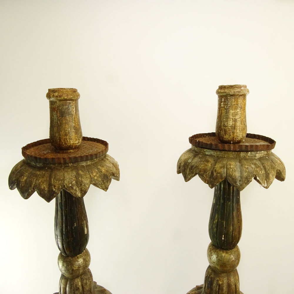 Lot 14 - Pair of early 20th Century Italian carved painted and silver gilt candle torchieres. Unsigned.