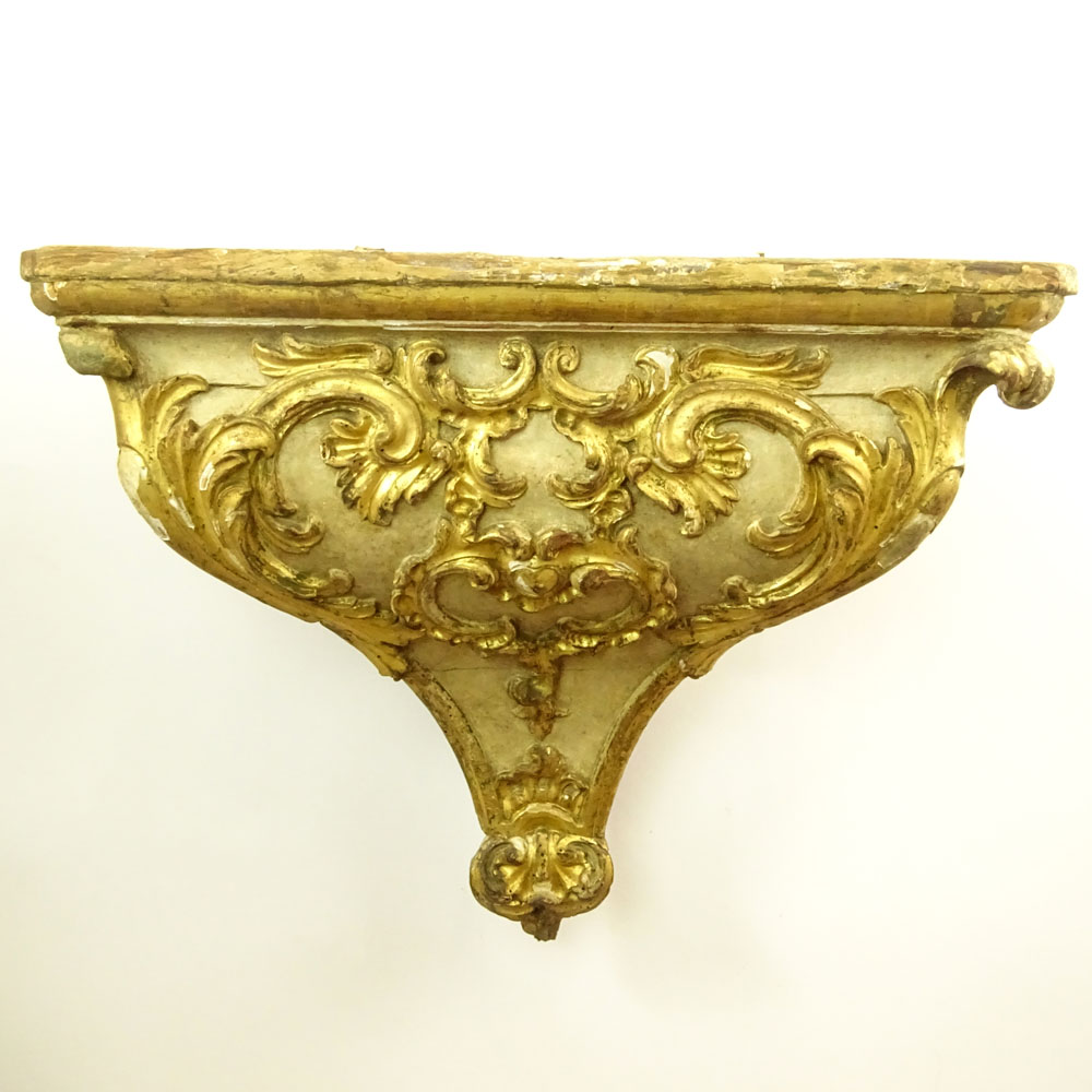 19/20th Century Probably Italian Carved Parcel Gilt Wood Wall Bracket. Unsigned. Losses, wear, age
