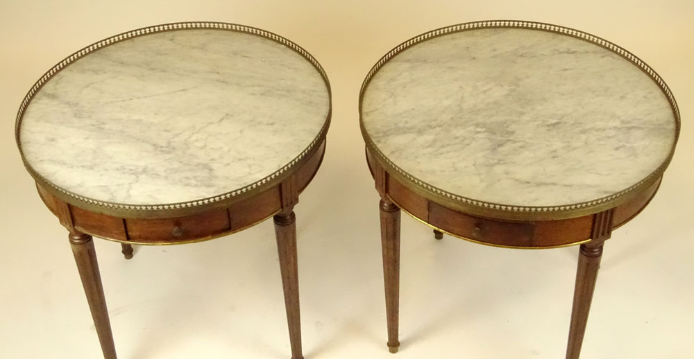 Lot 29 - Pair of mid 20th century Italian Louis XVl style mahogany bouillotte tables with marble tops and