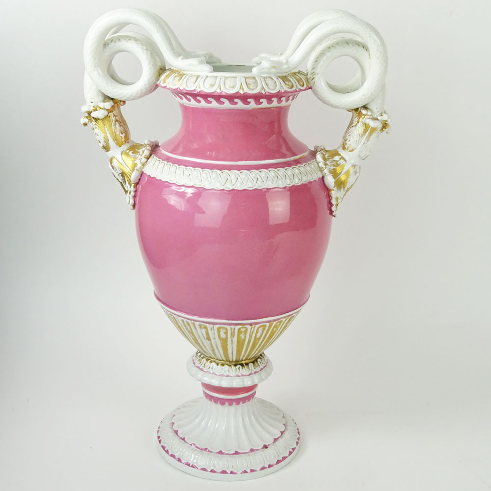 Lot 38 - Large Meissen Snake Handle Porcelain Bolted Urn in Pink White and Parcel Gilt. Signed with crossed