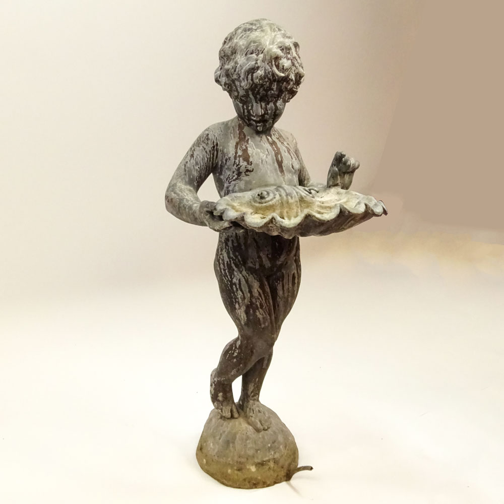 Early 20th Century Iron Figural Standing Putto holding Shell Fountain. Unsigned. Distressed