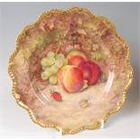 A Worcester porcelain cabinet plate, decorated with fruit on a mossy bank by R. Sebright, signed