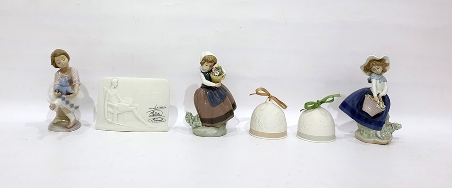 Lot 36 - Three Lladro porcelain modelsof girls with flowers and teddy bear, variously, pair of Lladro tinted