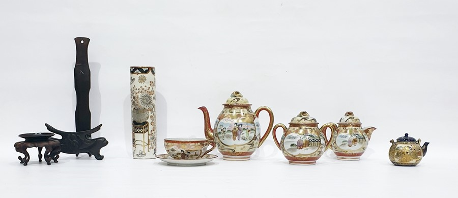 Lot 86 - Japanese Satsuma part tea servicepainted in gilt with figures before pavillions, in garden