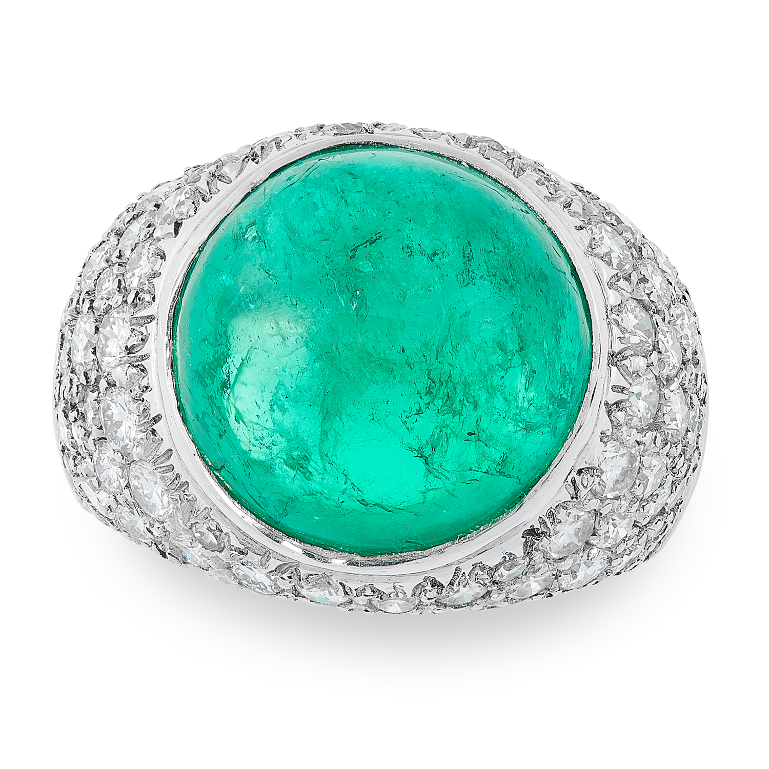 A COLOMBIAN EMERALD AND DIAMOND RING CIRCA 1980 in platinum, set with a circular cabochon emerald of