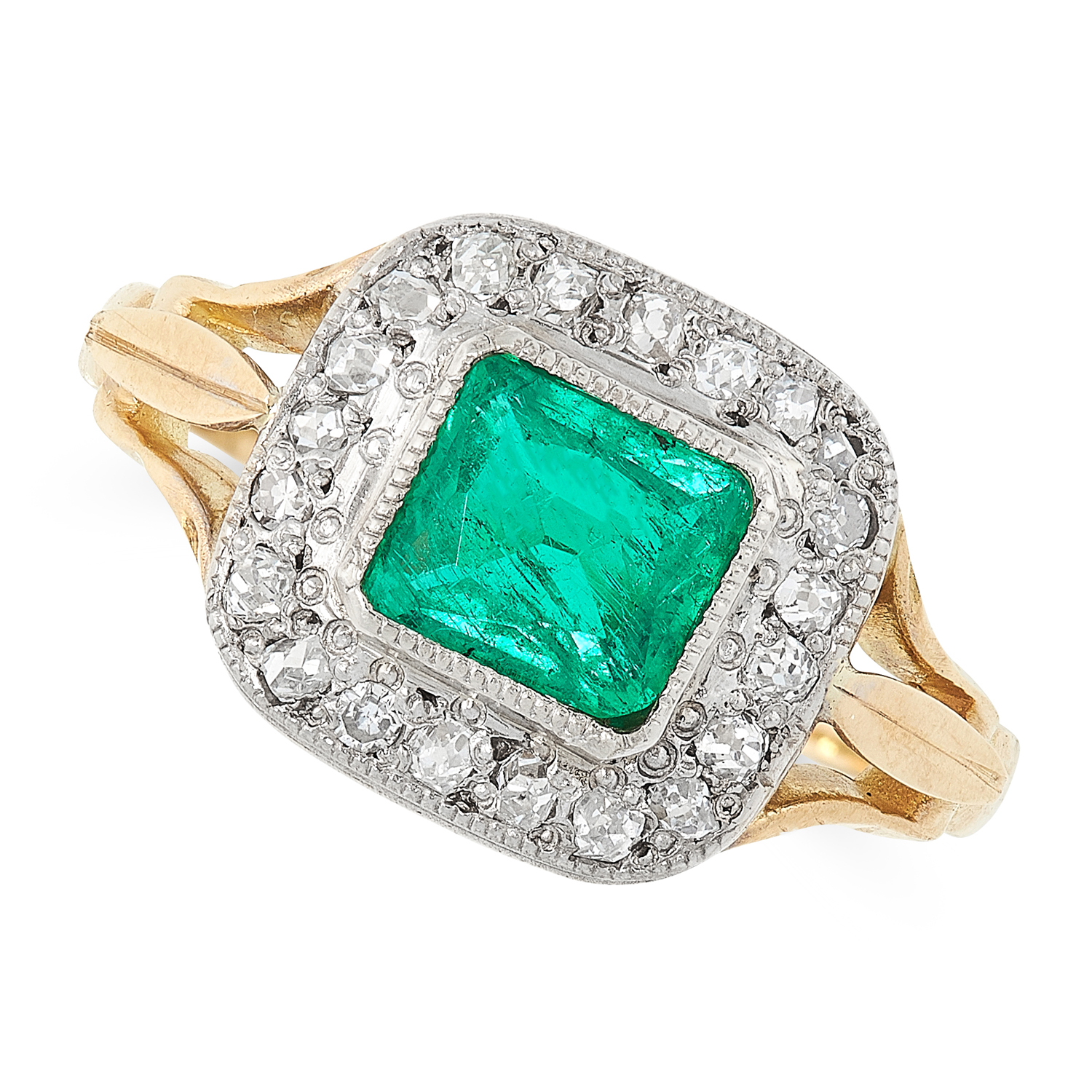 AN EMERALD AND DIAMOND RING in 18ct yellow gold, set with a mixed cut emerald within a border of