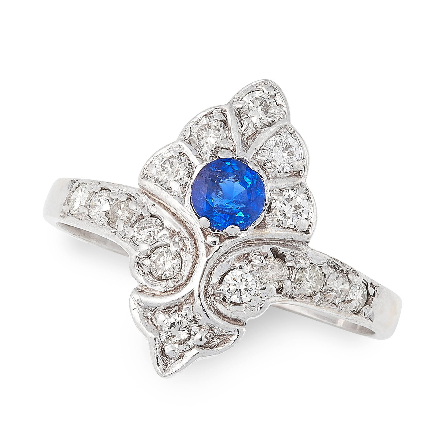 A SAPPHIRE AND DIAMOND DRESS RING of shield design, set with a round cut sapphire accented by