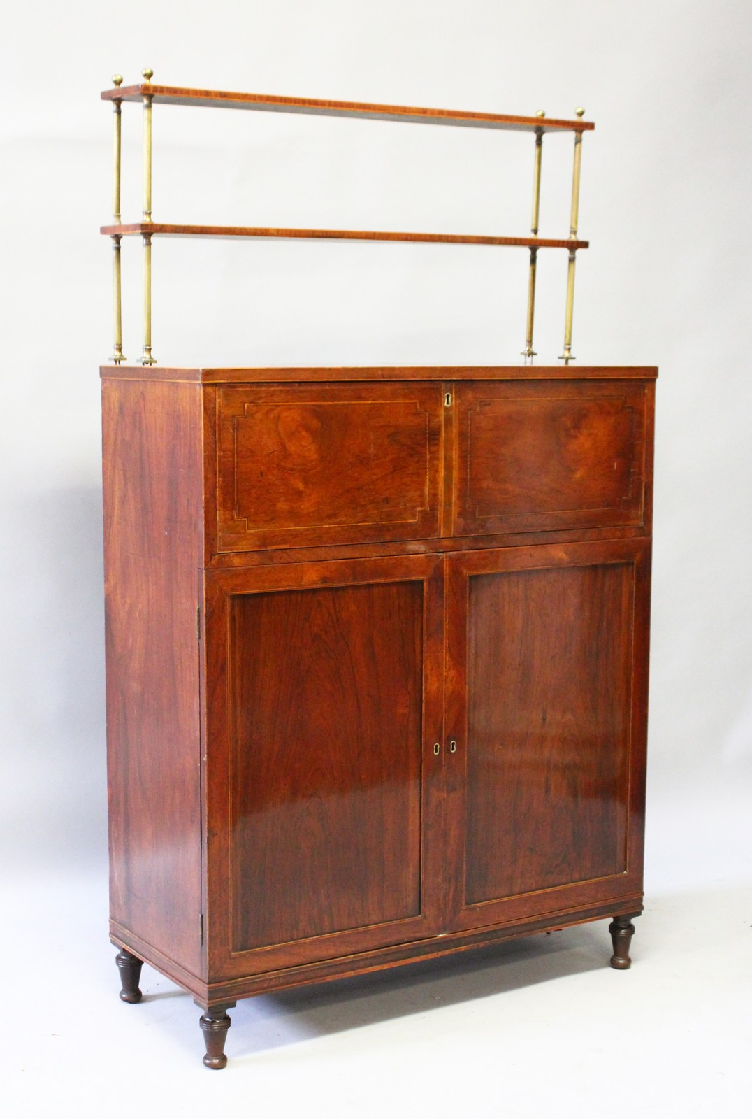 a good regency mahogany secretaire chiffonier with brass gallery with two shelves on a base with. Black Bedroom Furniture Sets. Home Design Ideas