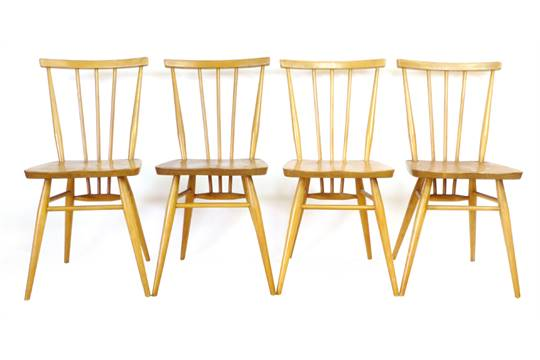A set of four Ercol elm and beech spindle back dining chairs