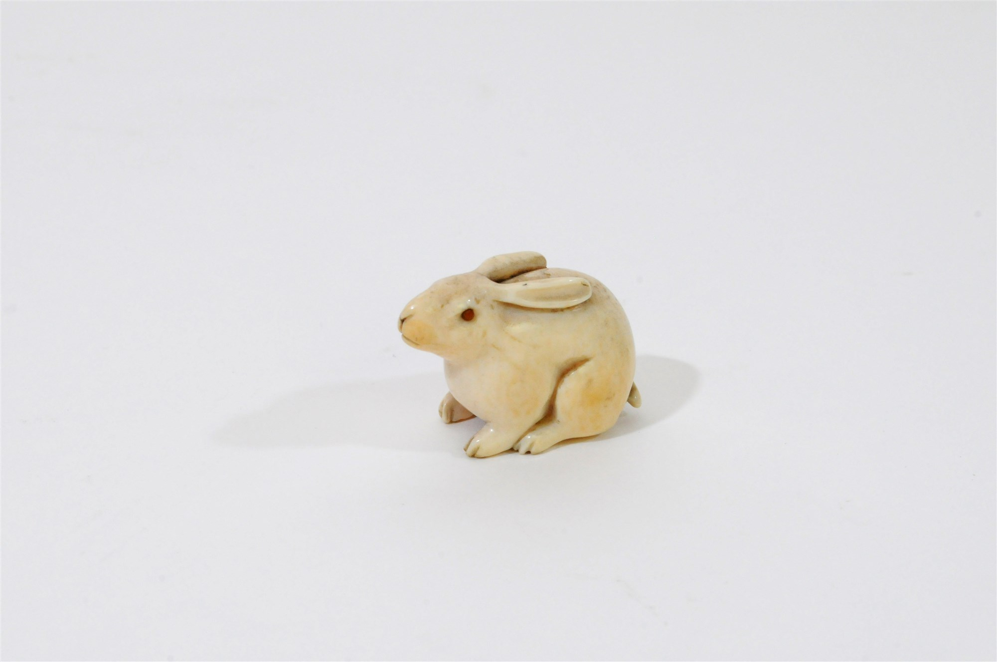 Lot 330 - A Japanese carved ivory study of the lunar hare