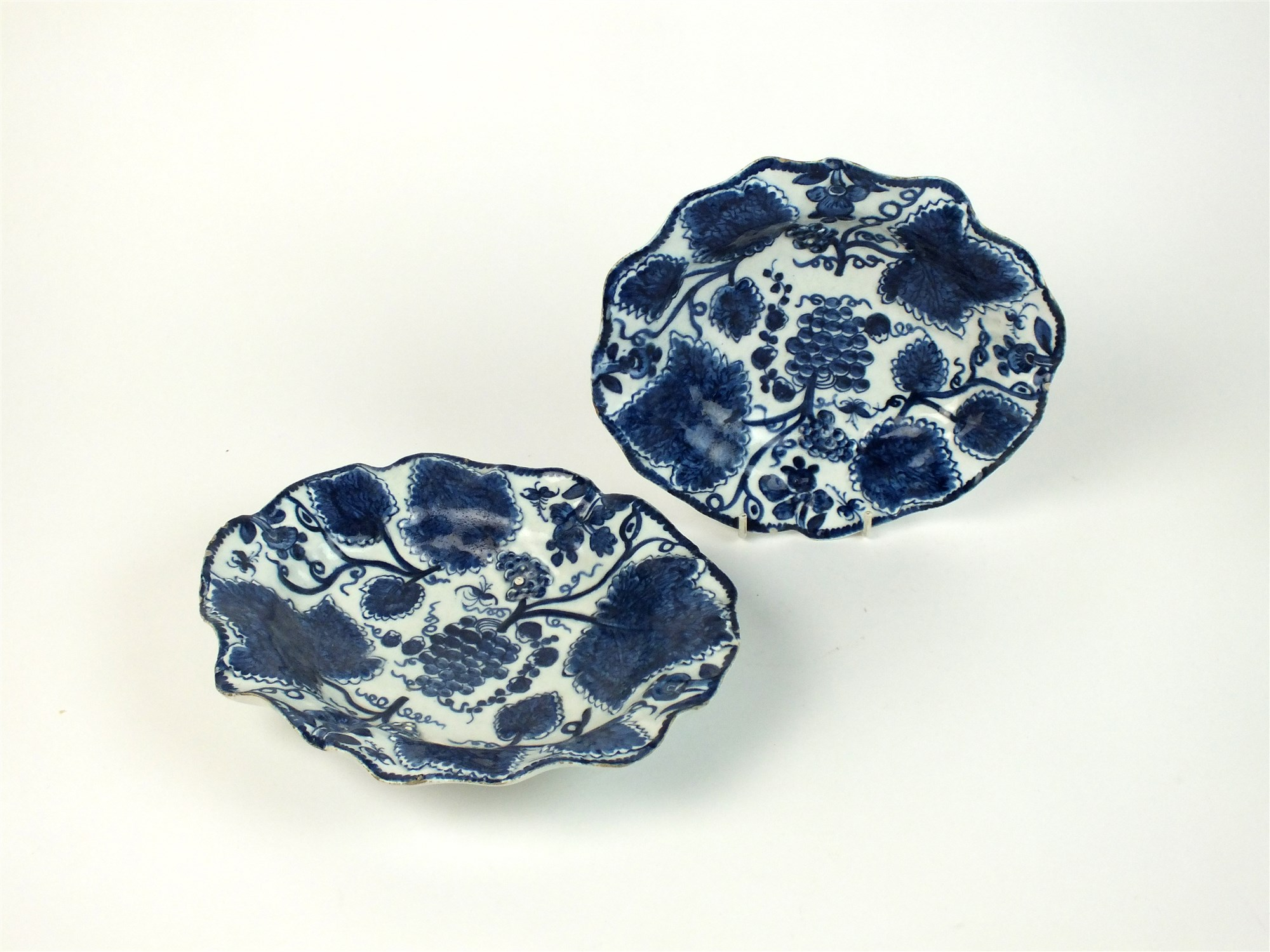 Lot 32 - Two 18th century Bow porcelain blue and white dishes