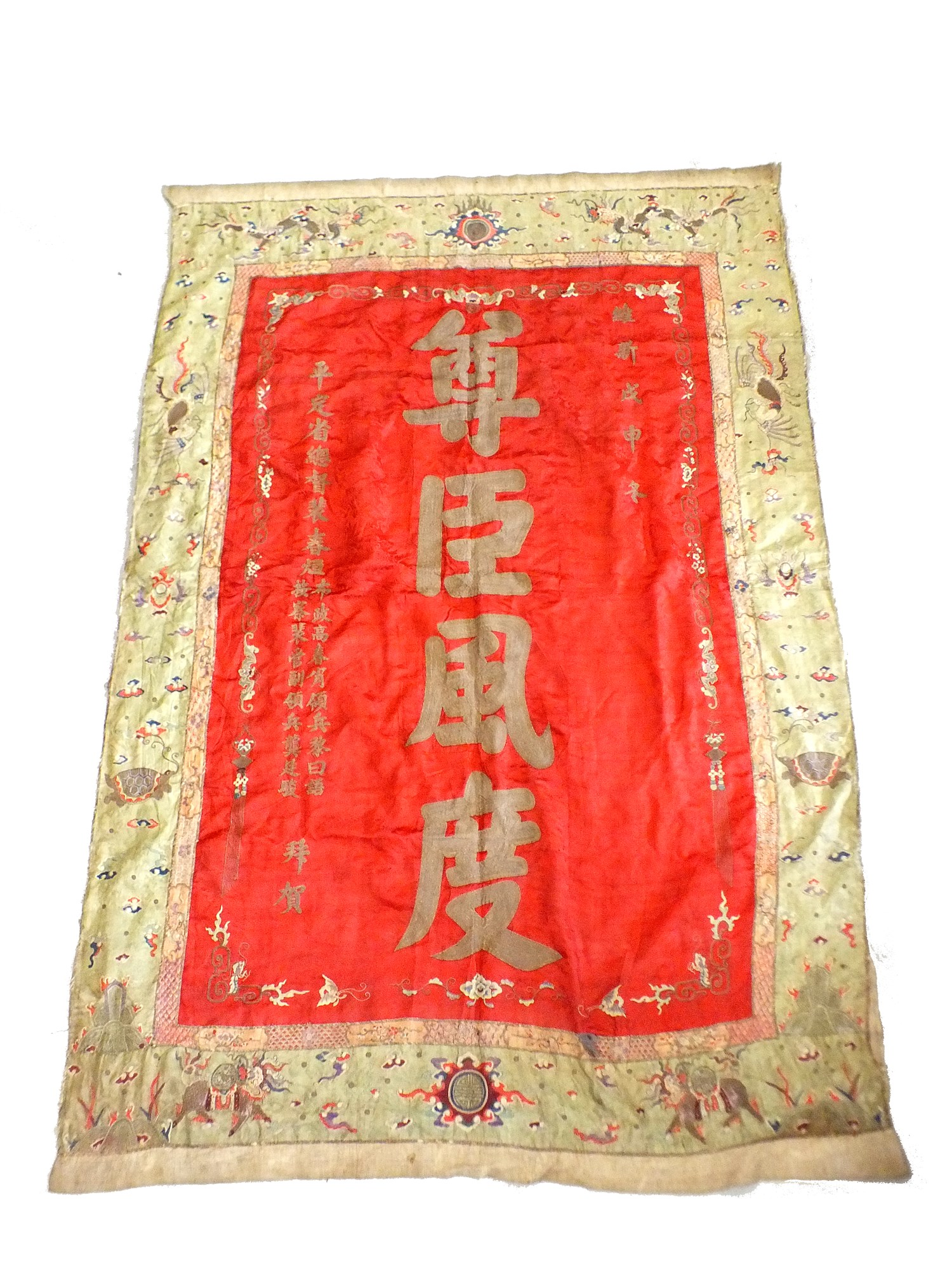 Lot 222 - A large Chinese red silk wall hanging