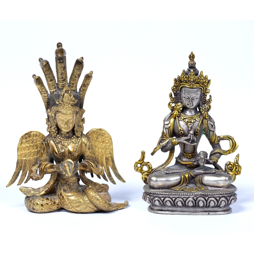Lot 37 - Two figures Sino-Tibetan, 20th Century the first depicted sitting down holding a vajra in one
